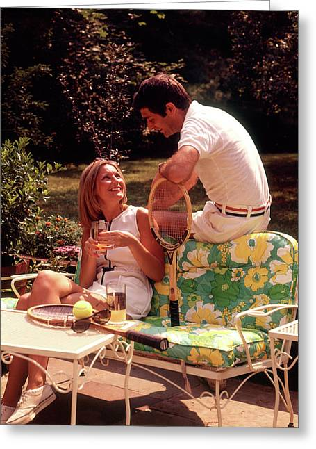 1970s Relaxing Couple Sitting On Patio Greeting Card