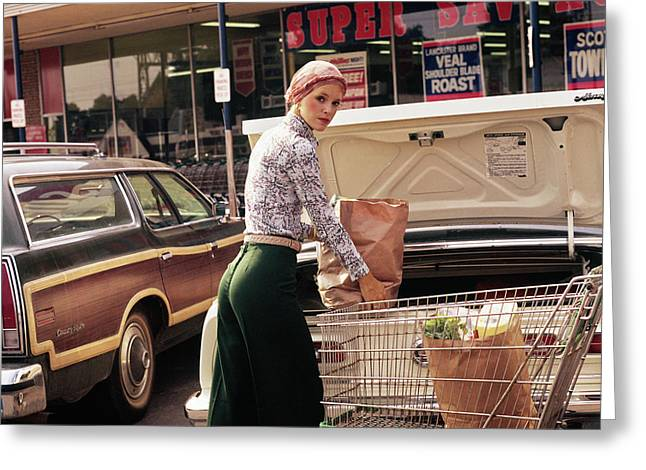 1970s Woman Putting Grocery Bags Greeting Card
