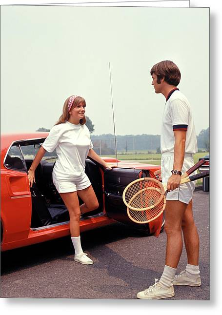 1970s Young Couple Getting Out Of Car Greeting Card