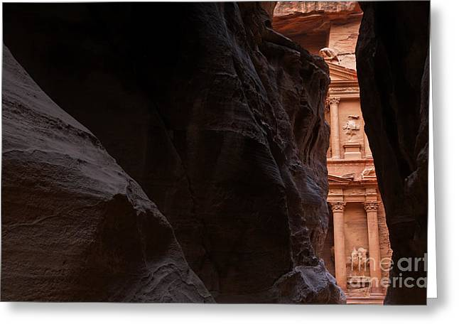 A Glimpse Of Al Khazneh From The Siq In Petra Jordan Greeting Card by Robert Preston