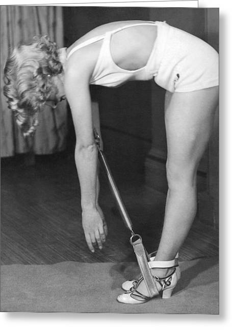 A Young Woman Exercising Greeting Card by Underwood Archives