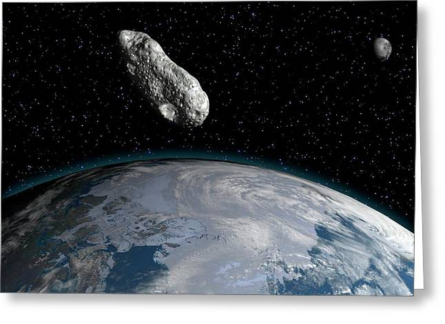Asteroid Greeting Card by Juan Gaertner