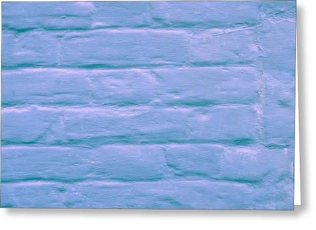 Blue Brick Wall Greeting Card by Tom Gowanlock