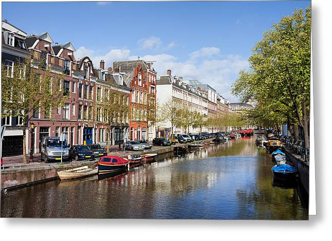 Boats On Amsterdam Canal Greeting Card by Artur Bogacki