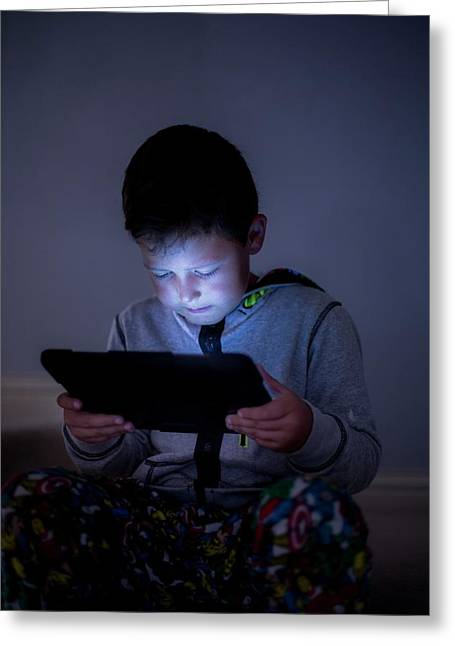 Boy Using A Digital Tablet In The Dark Greeting Card
