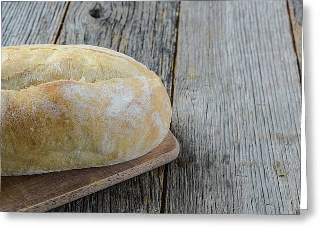 Bread On A Bread Board With Rustic Wood Background Greeting Card