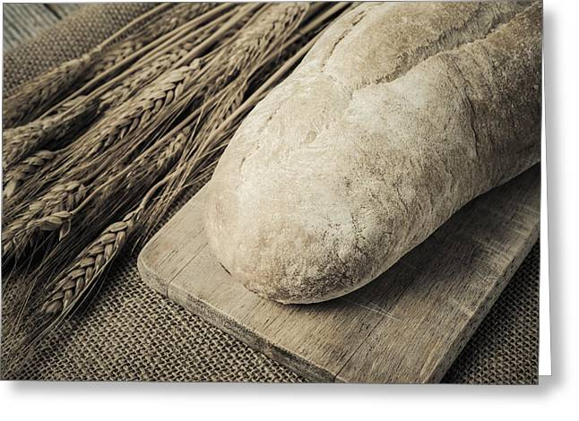 Bread On Bread Board With Wheat On Burlap Background Greeting Card