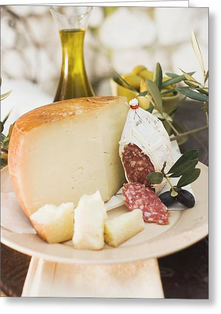 Cheese, Salami, Olives And Olive Oil On Table Out Of Doors Greeting Card