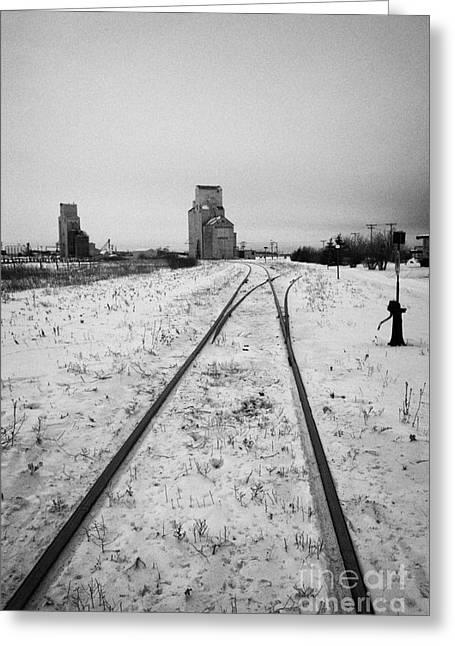 Cn Canadian National Railway Tracks And Grain Silos Kamsack Saskatchewan Canada Greeting Card by Joe Fox