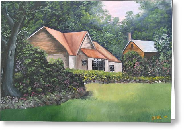 Cottage In The Woods Greeting Card by June Weaver
