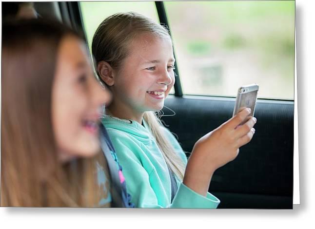 Girl Using Smartphone In Car Greeting Card