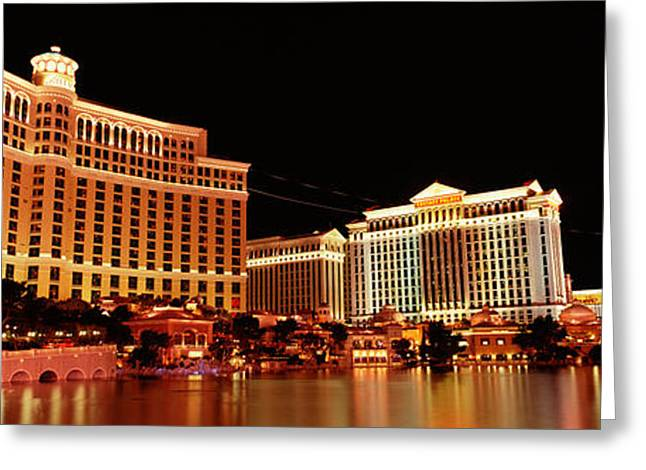 Hotel Lit Up At Night, Bellagio Resort Greeting Card by Panoramic Images