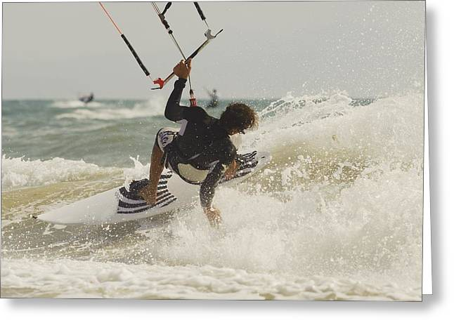 Kitesurfer Catching A Wave Greeting Card by Ben Welsh