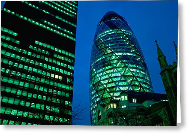 Low Angle View Of Buildings Lit Greeting Card by Panoramic Images