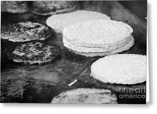 Raw And Cooked Processed Hamburgers On A Commercial Flat Grill At An Outdoor Event Greeting Card