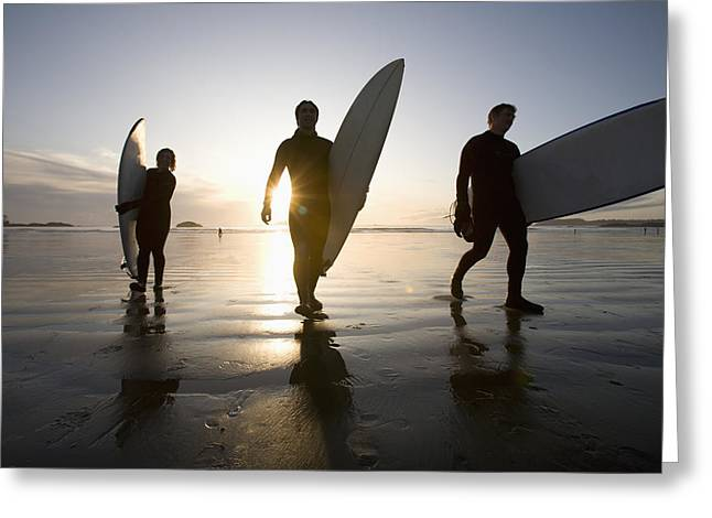Silhouette Of Three Surfers Carrying Greeting Card by Deddeda
