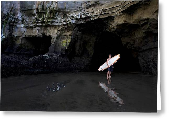 Surfer Inside A Cave At Muriwai, New Greeting Card by Deddeda