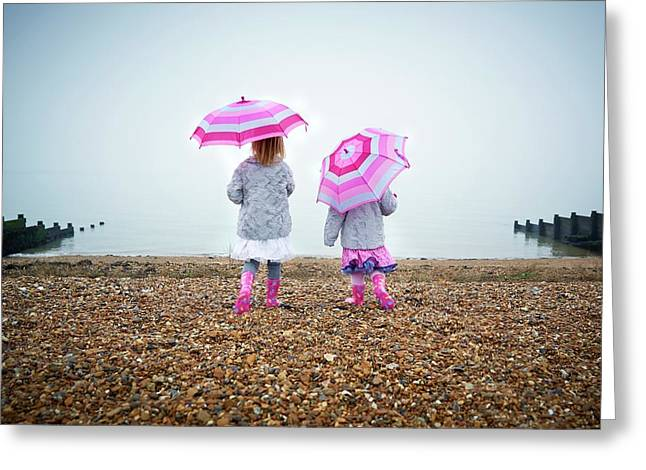 Two Girls On Beach Holding Umbrellas Greeting Card by Ruth Jenkinson