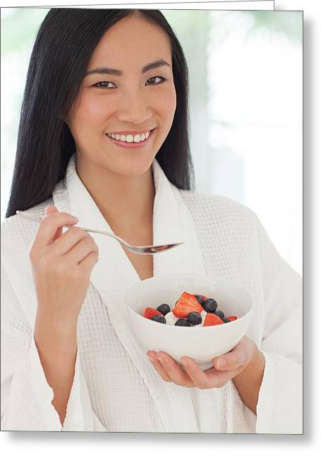 Woman Holding Bowl Of Fruit Greeting Card by Ian Hooton