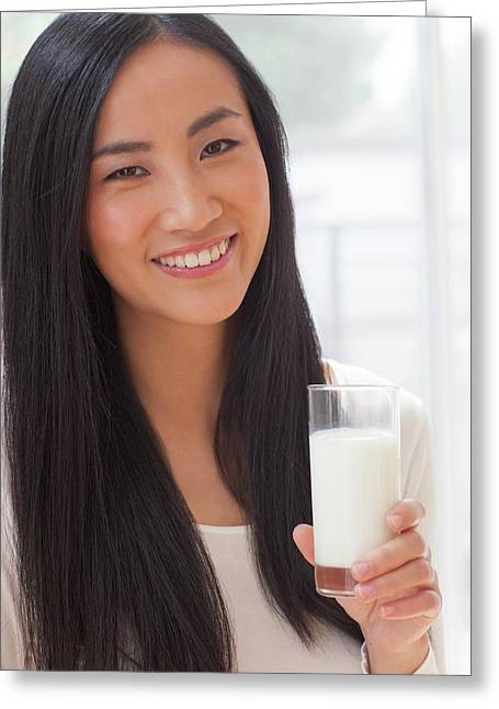 Woman Holding Glass Of Milk Greeting Card by Ian Hooton