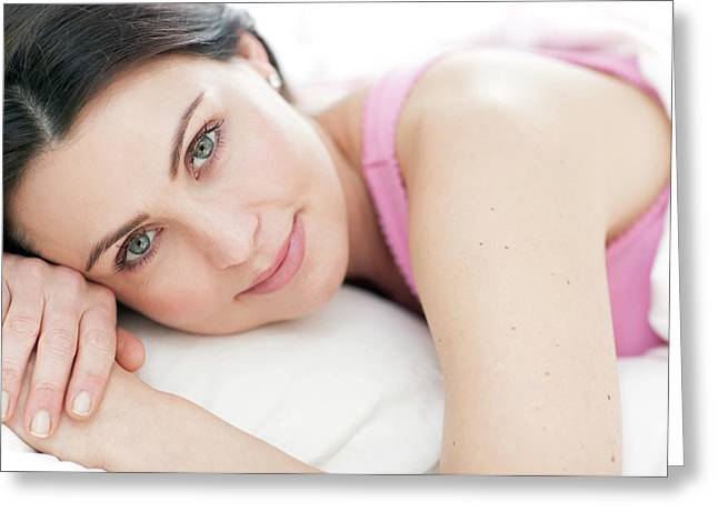 Woman Lying In Bed Greeting Card by Ian Hooton