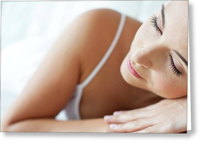 Woman Lying With Head On Hands Greeting Card