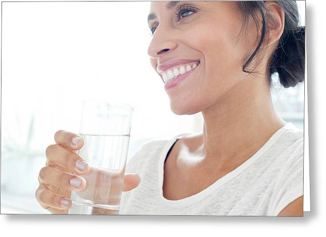 Woman With Glass Of Water Greeting Card by Science Photo Library