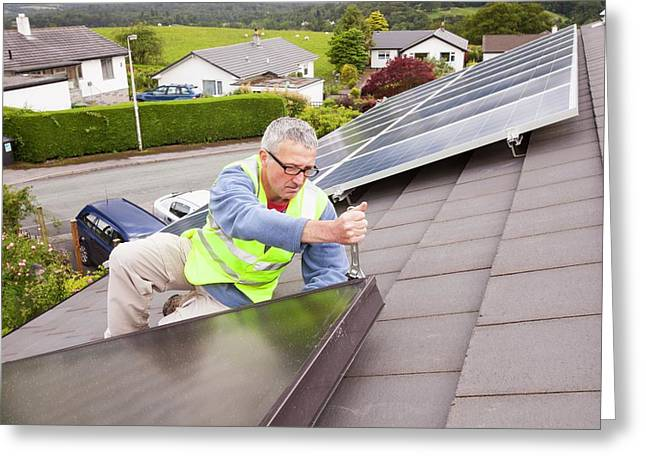 Workman Fitting Solar Thermal Panels Greeting Card by Ashley Cooper