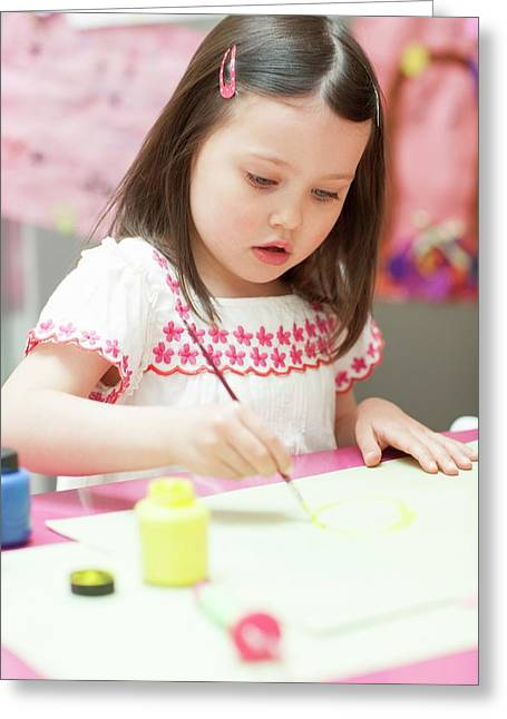 Young Girl Painting Greeting Card by Ian Hooton