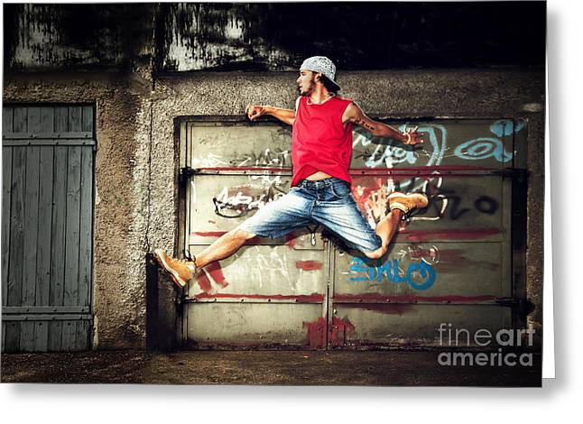 Young Man Jumping On Grunge Wall Greeting Card by Michal Bednarek