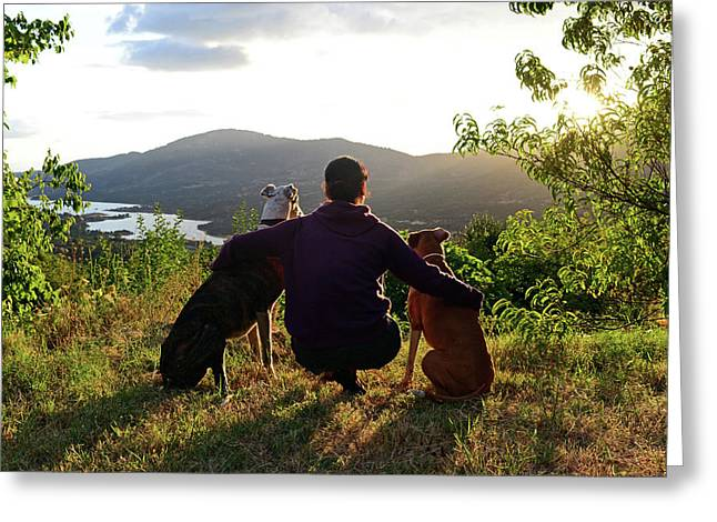 Young Woman With Her Dogs At Sunset Greeting Card