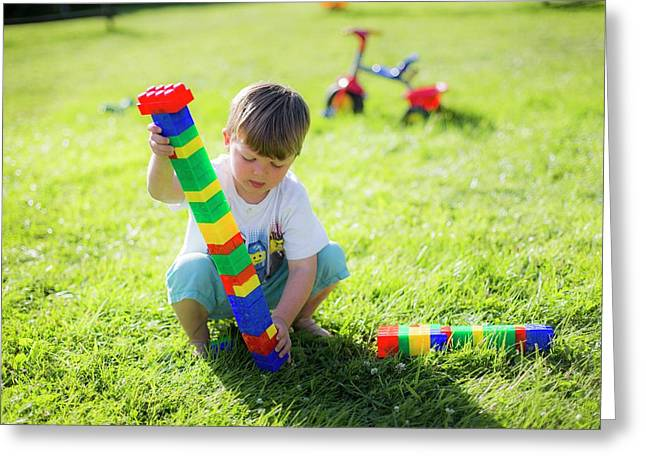 Boy Playing With Plastic Bricks Greeting Card