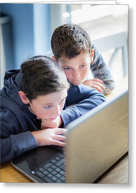 Boys Using Laptop Greeting Card by Samuel Ashfield