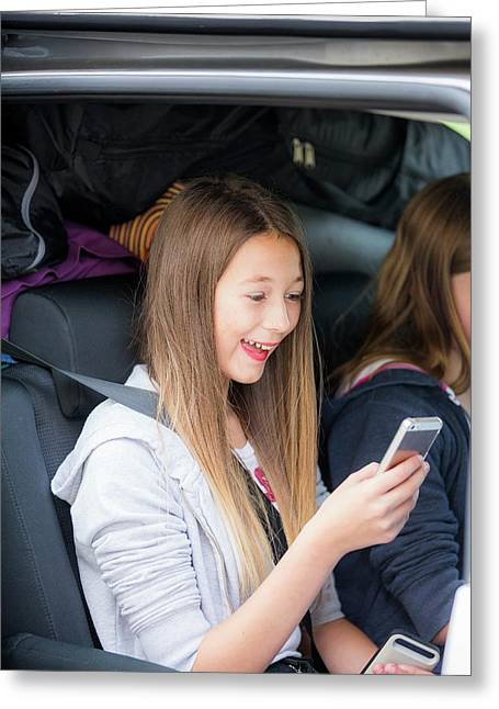 Girl Using Smartphone In Car Greeting Card