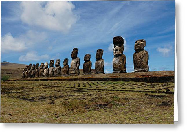 Low Angle View Of Moai Statues Greeting Card by Panoramic Images