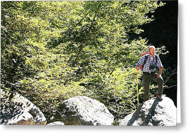 Man Hiking In The Sun Greeting Card by Mauro Fermariello/science Photo Library