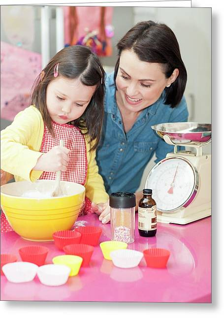 Mother And Daughter Baking Greeting Card by Ian Hooton
