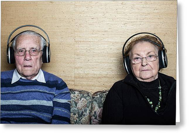 Senior Couple Wearing Headphones Greeting Card by Mauro Fermariello