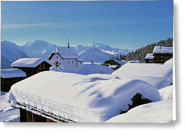 Snow Covered Chapel And Chalets Swiss Greeting Card by Panoramic Images