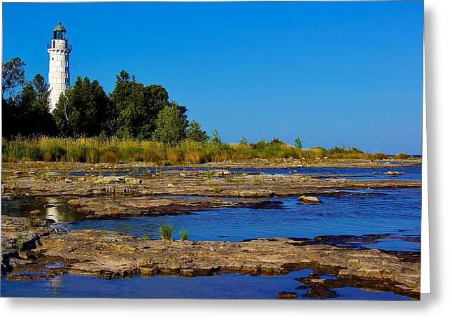 The Cana Island Lighthouse In Baileys Harbor Reflective Waters. Greeting Card by Carol Toepke