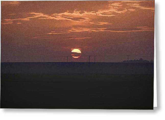 The Setting Sun In The Distance With Clouds Greeting Card