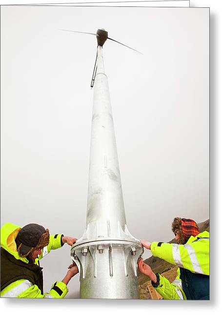 Three Wind Turbines Being Constructed Greeting Card by Ashley Cooper