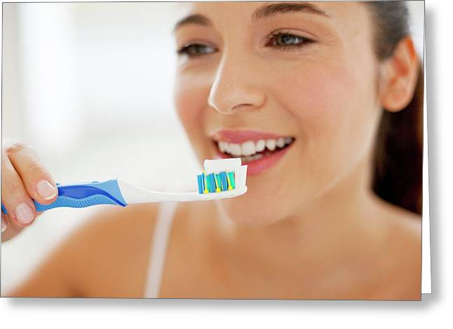 Woman Brushing Teeth Greeting Card by Ian Hooton