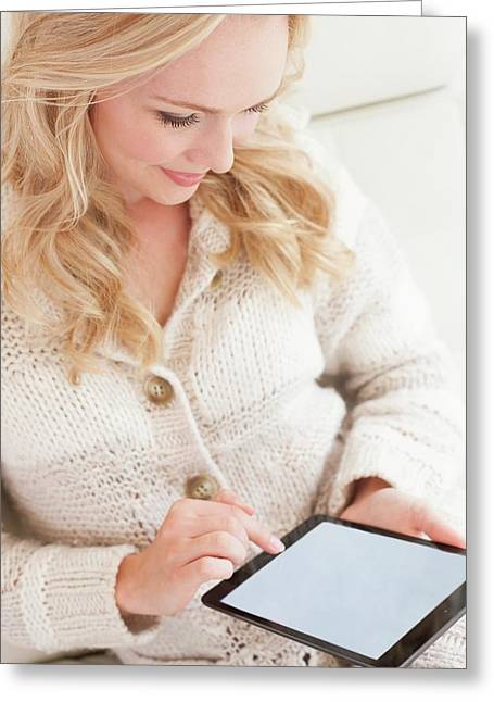 Woman Using Digital Tablet Greeting Card by Ian Hooton