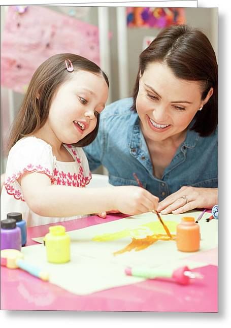 Young Girl Painting Greeting Card