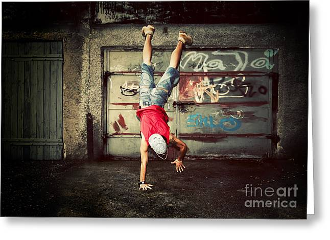 Young Man Jumping On Grunge Wall Greeting Card