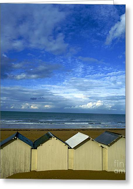 Beach Huts Under A Stormy Sky In Normandy. France. Europe Greeting Card by Bernard Jaubert