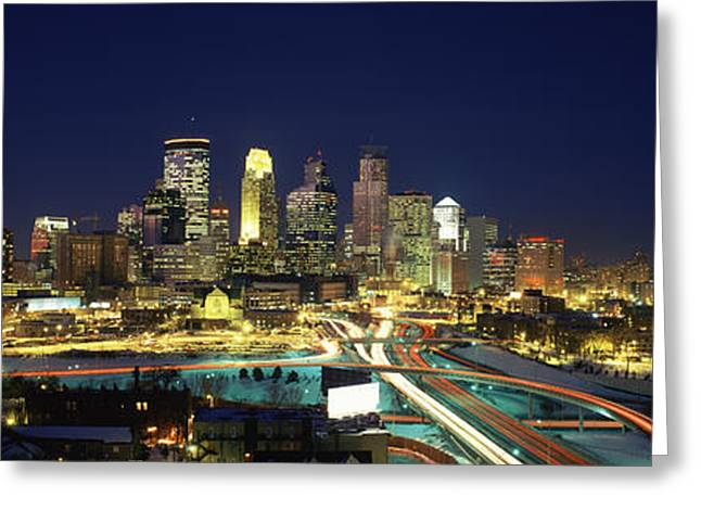 Buildings Lit Up At Night In A City Greeting Card by Panoramic Images