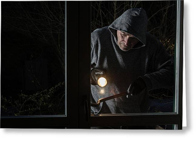 Man Breaking Into Building Greeting Card