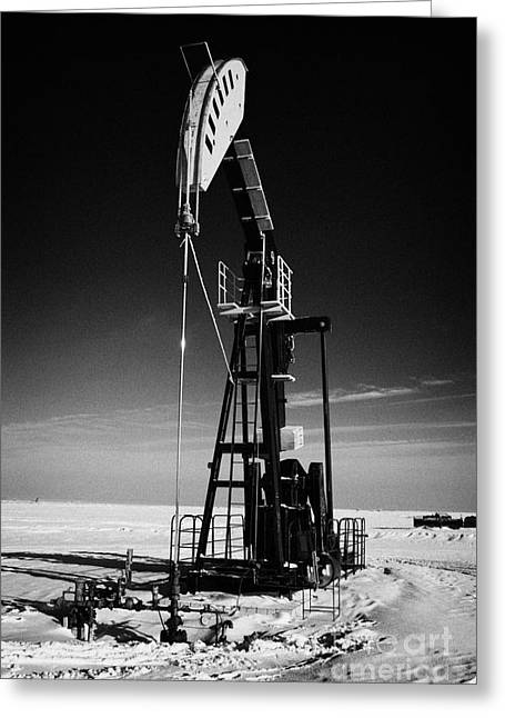 oil pumpjack in winter snow Forget Saskatchewan Canada Greeting Card